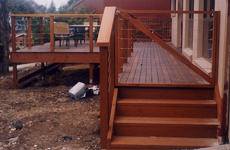 Timber deck with stainless steel wire in handrail.
